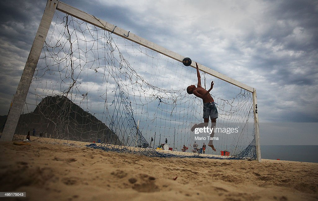 A boy practices defending penalty kicks with friends on Copacabana Beach on June 1, 2014 in Rio de Janeiro, Brazil. Brazil has won five World Cups, more than any other nation. The 2014 FIFA World Cup kicks off June 12 in Brazil.