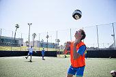 Boy practicing soccer header