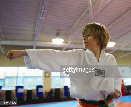 Boy Practicing Tae Kwon Do Punch : Photo