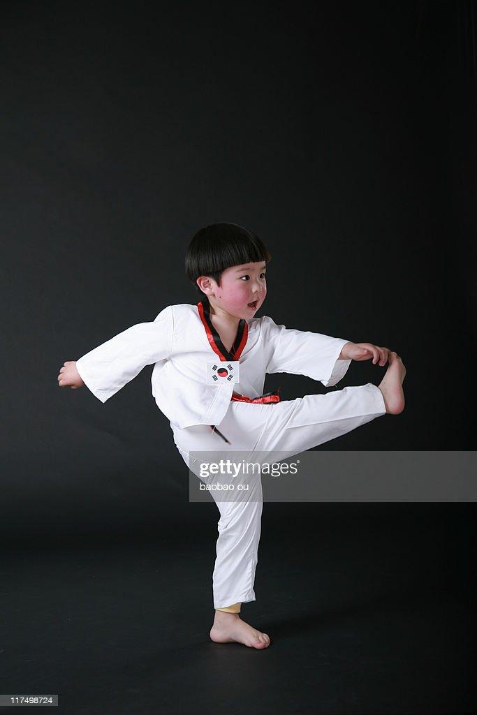 Boy practicing taekwondo : Stock Photo