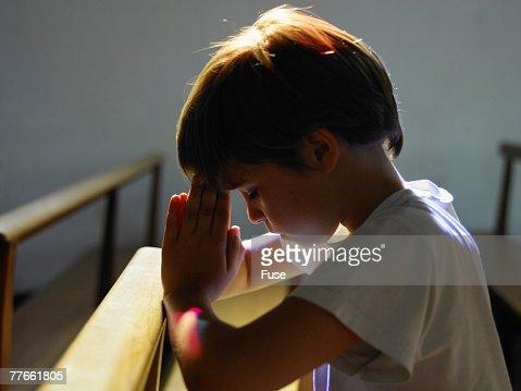 Boy Praying in Church