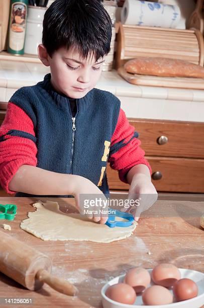 Boy preparing biscuits