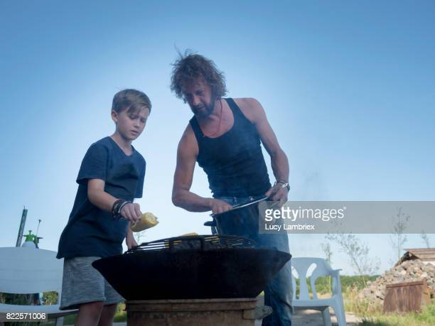 Boy preparing food with his father
