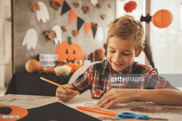 Boy preparing Halloween decoration