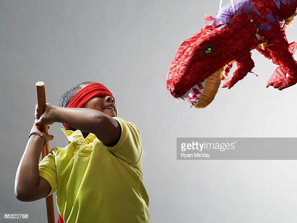 Boy preparing to hit pinata
