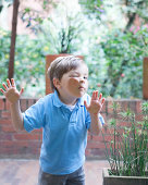 Boy pressing face against glass