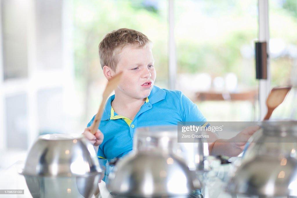 Boy pretending to be drummer : Stock Photo