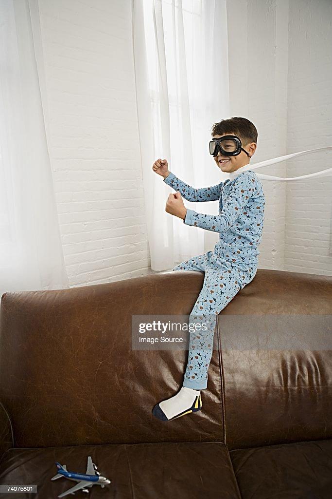 Boy pretending to fly : Stock Photo