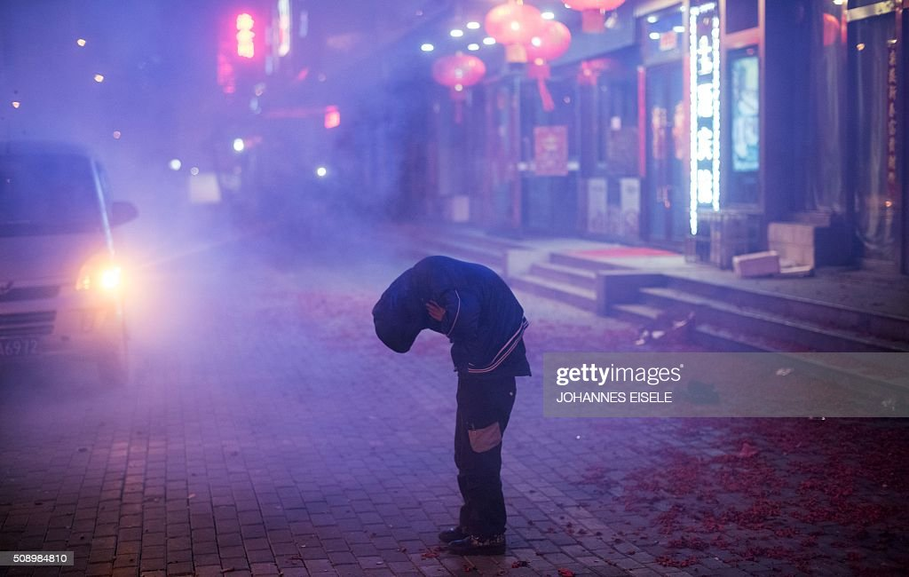 A boy protects himself from the sound of firecrackers during Lunar New Year celebrations at the Chinese border town of Dandong, opposite to the North Korean town of Sinuiju, early on February 8, 2016, a day after North Korea said it had successfully put a satellite into orbit. The UN Security Council strongly condemned North Korea's rocket launch on February 7 and agreed to move quickly to impose new sanctions that will punish Pyongyang for 'these dangerous and serious violations.' With backing from China, Pyongyang's ally, the council again called for 'significant measures' during an emergency meeting held after North Korea said it had put a satellite into orbit with a rocket launch. AFP PHOTO / JOHANNES EISELE / AFP / JOHANNES EISELE
