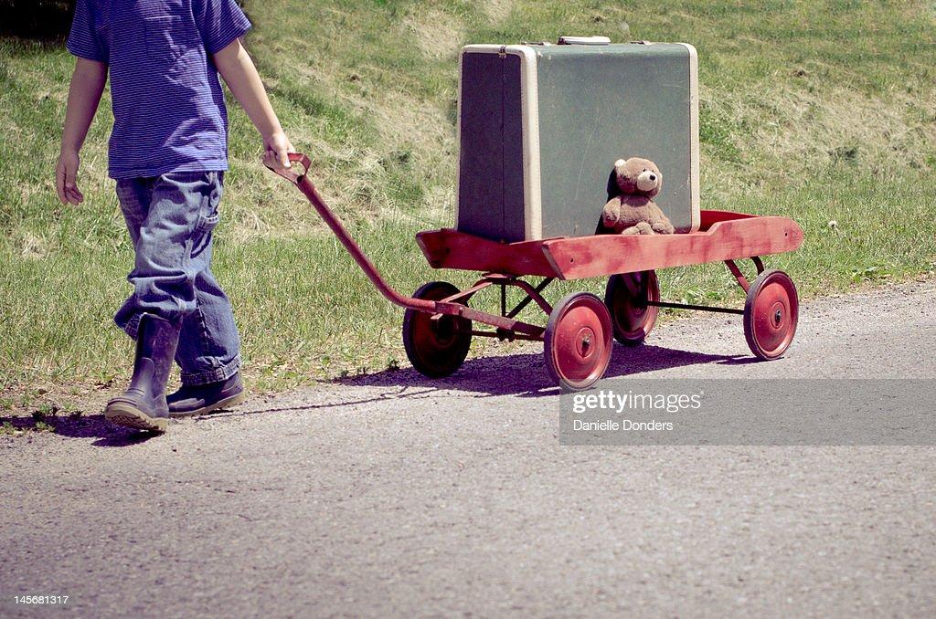 Boy Pulling Wagon : Boy pulling wagon stock photo getty images
