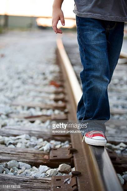boy railroad tracks portraits