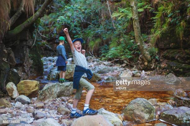Boy raising arm in success