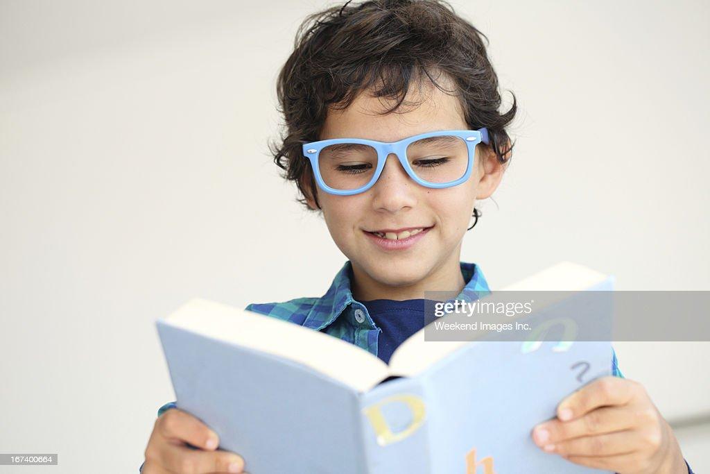 Boy reading  a book : Stock Photo