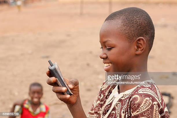 A boy reading a message on his mobile phone