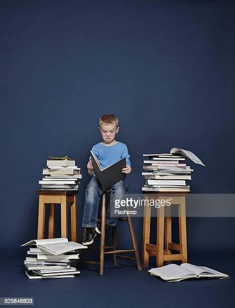 Boy reading books.