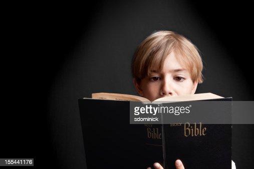 Boy Reading Holy Bible