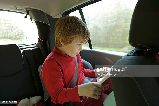 Boy reading in the car