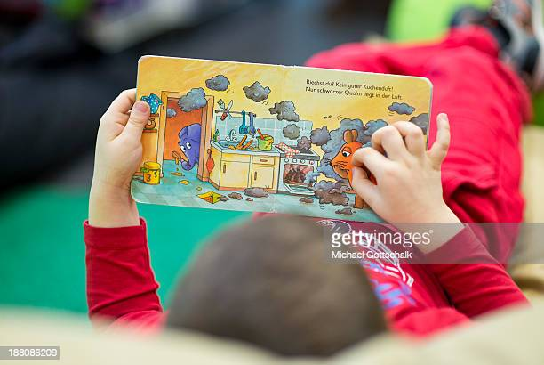 A boy reads children's books during the presentation of Project 'Lesestart' in a Libary for Children on November 15 2013 in Berlin Germany The...