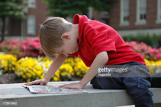 Boy Reads Outside