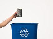 Boy recycling a tin can