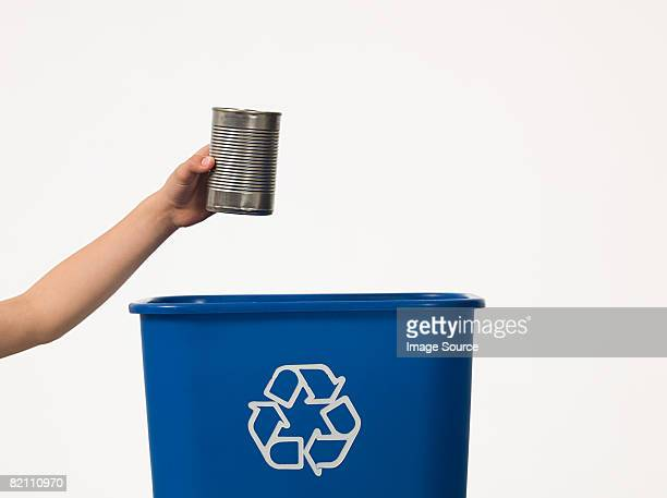 Boy recycling a tin can