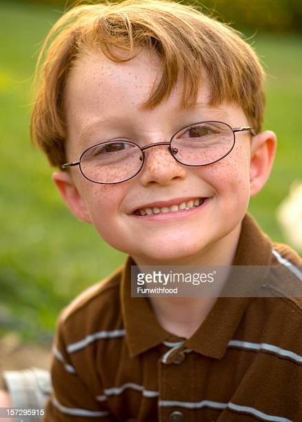 Boy Redhead & Freckles Happy in Glasses, Child Smiling Wearing Eyeglasses