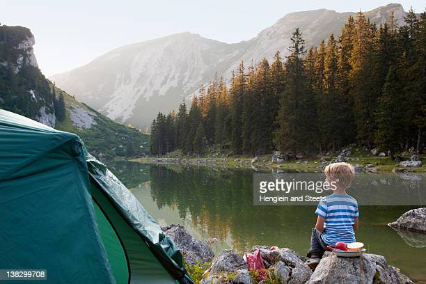Boy relaxing at campsite