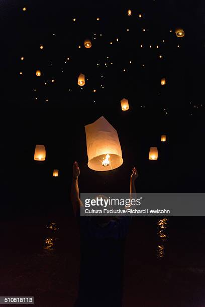 Boy releasing chinese lanterns on New Year's Eve, Krabi, Thailand, Southeast Asia