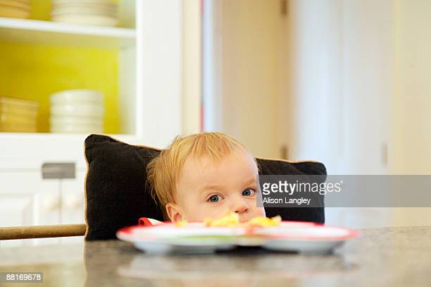 Boy reluctant to eat breakfast
