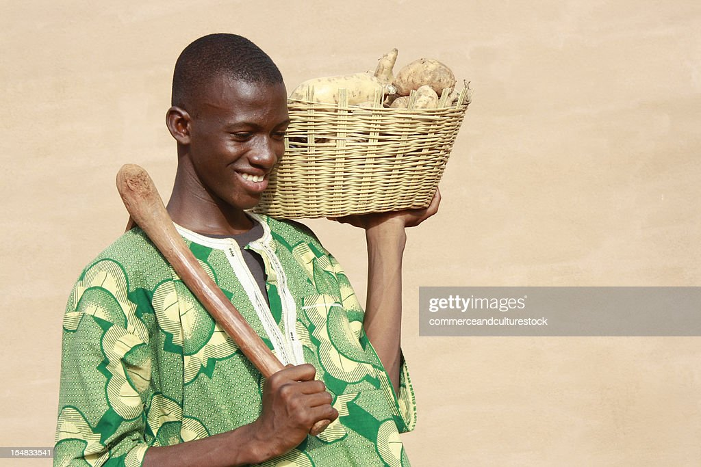 Boy returning from the market with yams : Stock Photo