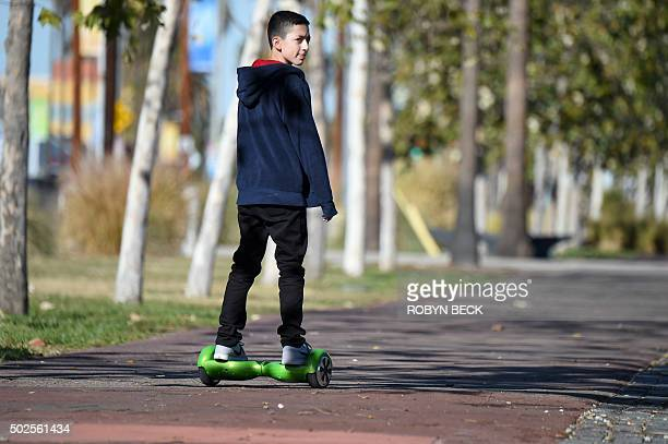 A boy rides a hoverboard on the day after Christmas in San Pedro California December 26 2015 Reports of some hoverboards also known as selfbalancing...