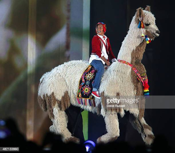 TORONTO ON JULY 26 A boy rides an alpaca as part of the hand over of the Pan Am Games to Lina Peru which will host the 2019 Pan Am Games in Lima...