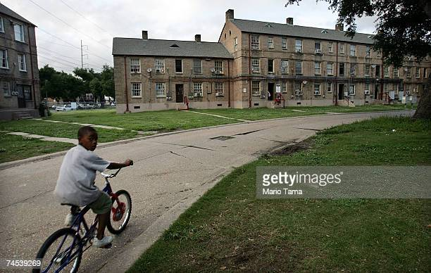 A boy rides his bicycle in the BW Cooper housing project June 7 2007 in New Orleans Louisiana Before Hurricane Katrina BW Cooper held about 1000...