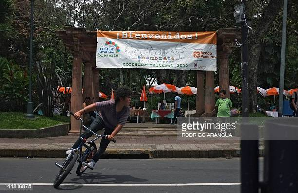A boy rides his bike at Morazan square in San Jose on May 19 2012 The Costa Rican Ministry of Culture and Youth is launching cultural activities...