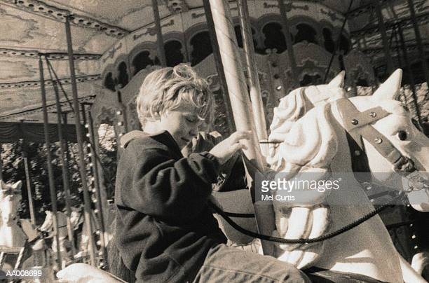 Boy Riding a Carousel