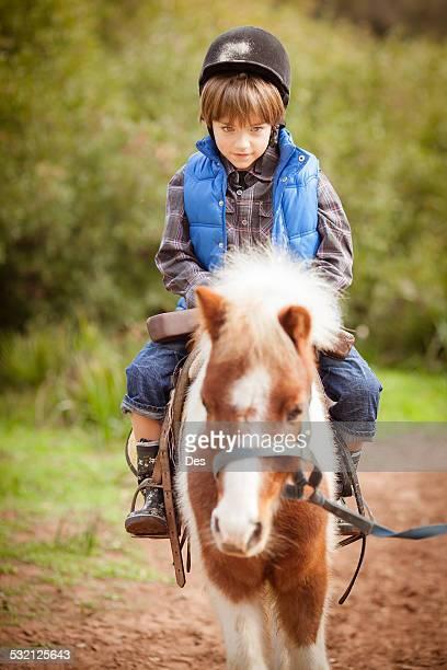 Boy riding a pony, Morocco