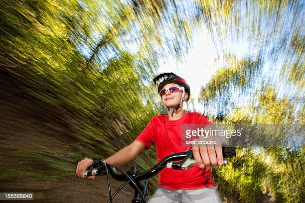 Boy Riding Bike on Mountain Trail