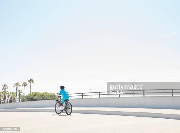 Boy riding his bike enthusiastically.