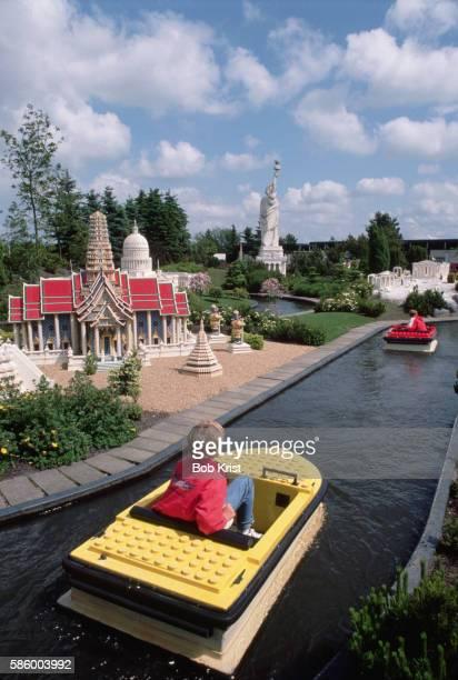 Boy Riding in Lego Boat