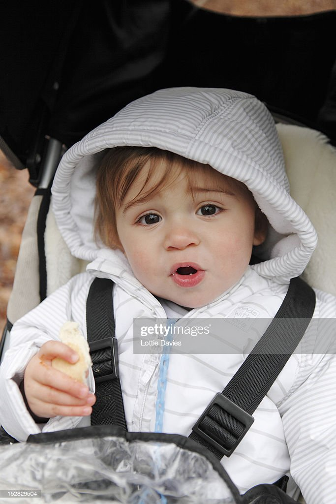 Boy riding in stroller outdoors