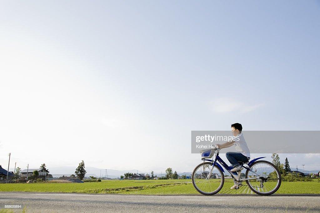 boy riding on bicycle : Stock Photo