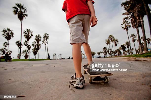 Boy riding on skateboard in park