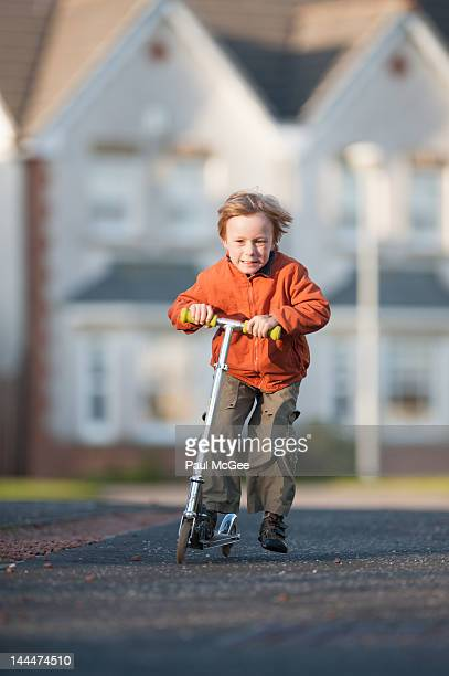 Boy riding scooter