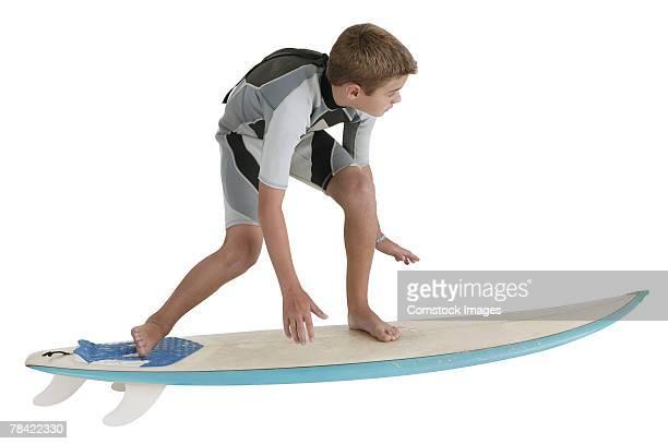 Boy riding surfboard