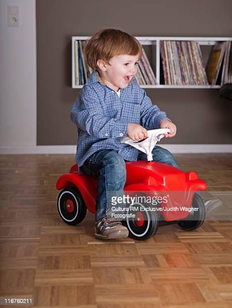 Cute Boy Riding A Toy
