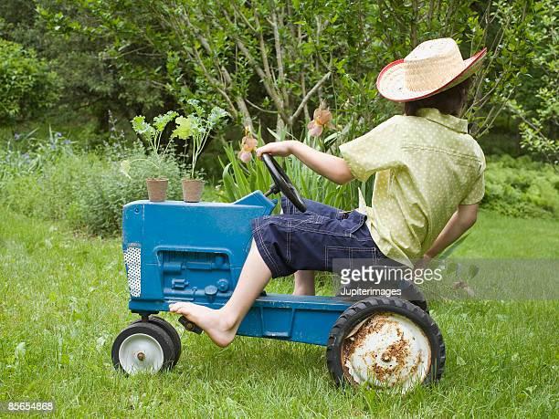 Boy riding tractor