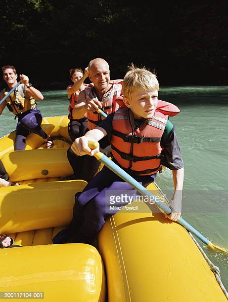 Boy (8-10) river rafting with family