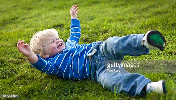 Boy rolling down the hill