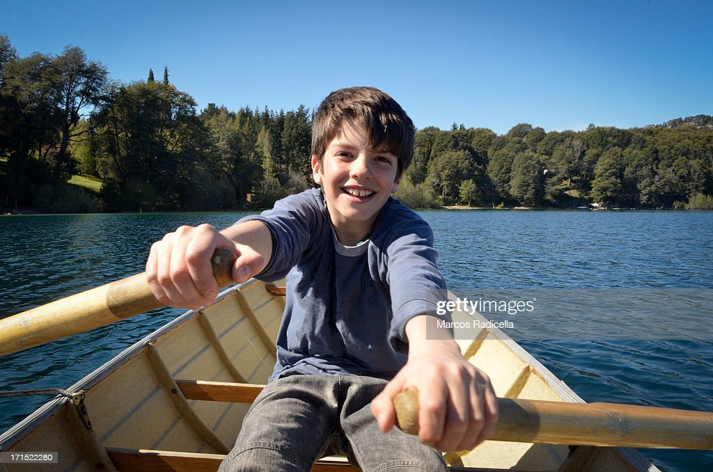 Boy rowing on the lake
