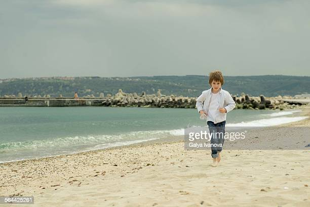 Boy running at the beach